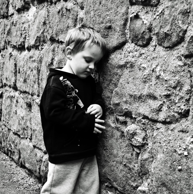 sad-child-at-a-stone-wall-George Hodan